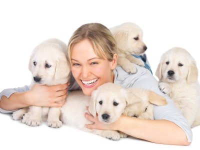 Cheerful young woman with her pet dogs